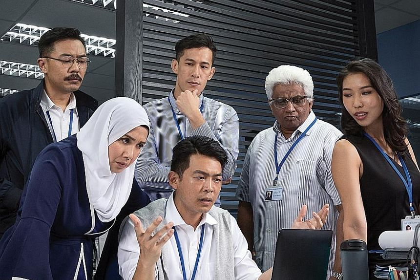 Former journalist Tan Tarn How depicts a newsroom in crisis in his first play in seven years, directed by Wild Rice's founding artistic director Ivan Heng and with a cast (above) including veteran theatre maker T. Sasitharan in his first acting role