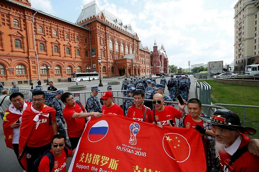 Chinese tourists visiting Moscow during the World Cup. Despite the world's most populous country failing to qualify for the tournament, their supporters have turned out in droves and are among the most numerous in Russia.