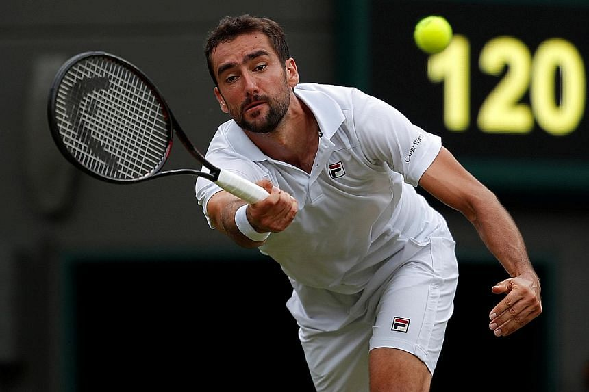 Croatia's Marin Cilic in action during his second-round match against Argentina's Guido Pella at Wimbledon yesterday, in which he suffered a shock 3-6, 1-6, 6-4, 7-6 (7-3), 7-5 defeat.