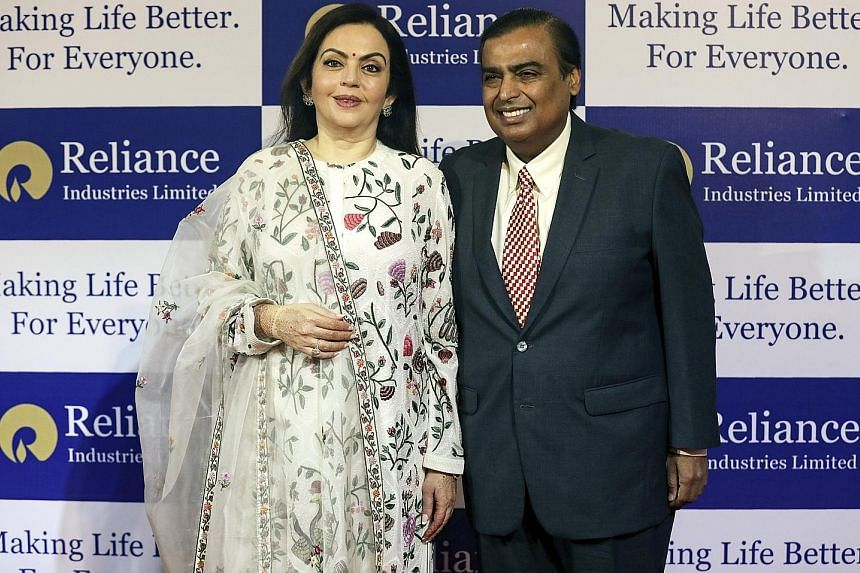 India's richest man Mukesh Ambani, chairman and managing director of Reliance Industries, pictured here with his wife Nita Ambani, has announced plans to expand into fibre-based broadband. Reliance sparked a price war in India's telecoms market when