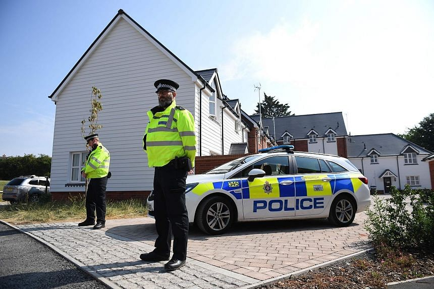 Police officers standing guard outside a home yesterday in Amesbury, southern England, where the British man and woman were taken ill last Saturday. Amesbury is 11km north of Salisbury, the site of the March attack on former double agent Sergei Skrip
