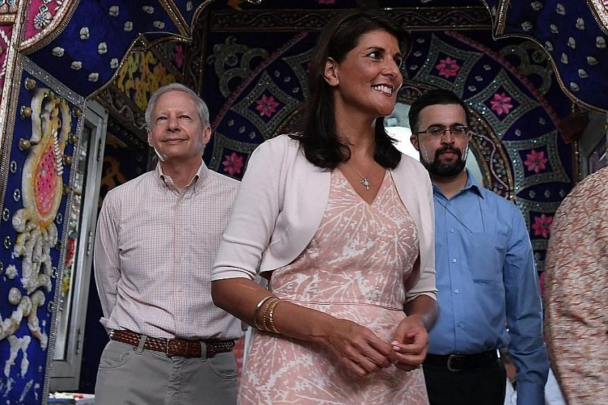 """US Ambassador to the UN Nikki Haley visiting the Gauri Shankar Hindu temple with US Ambassador to India Kenneth Juster (far left) in New Delhi on June 28. She was in India last week to deliver a message to New Delhi to stop oil imports and """"rethink"""""""
