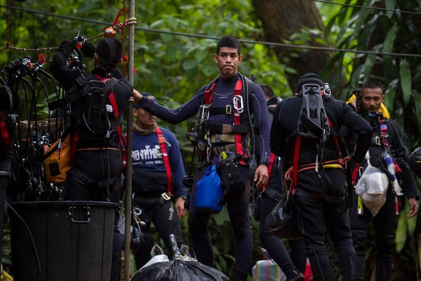 Thai divers carry supplies as rescue operations continue for 12 boys and their coach trapped at Tham Luang cave at Khun Nam Nang Non Forest Park in the Mae Sai district of Chiang Rai province, on July 5, 2018.