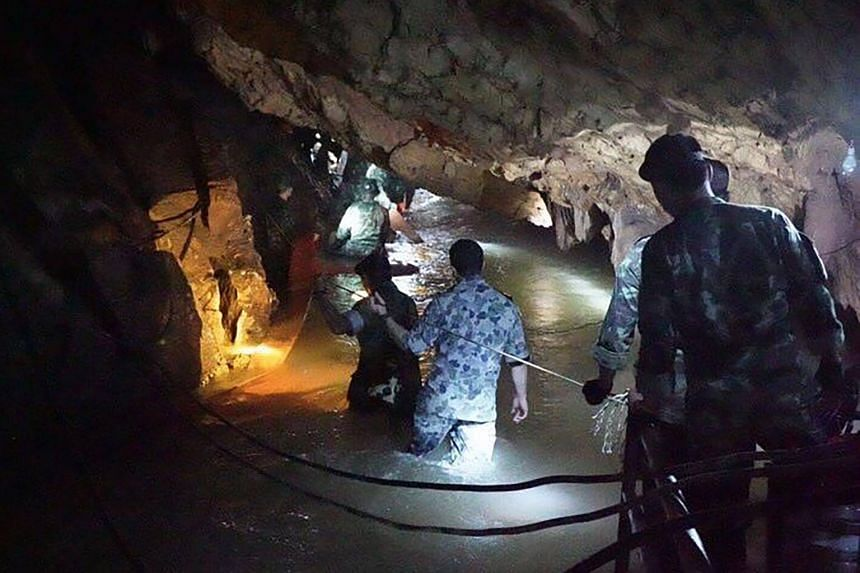A team of Royal Thai Navy Seal divers inspecting the water-filled tunnel in the Tham Luang cave during a rescue operation for the missing children's football team and their coach in Chiang Rai province, on June 29, 2018.