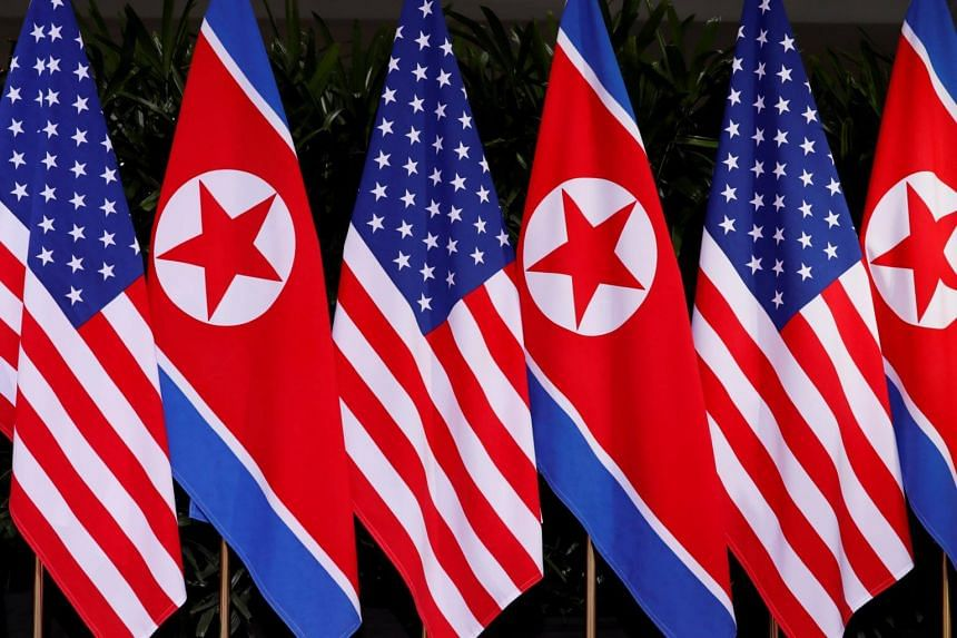 US and North Korean national flags during the meeting of US President Donald Trump and North Korean leader Kim Jong Un at the Capella Hotel on Sentosa island in Singapore, on June 12, 2018.