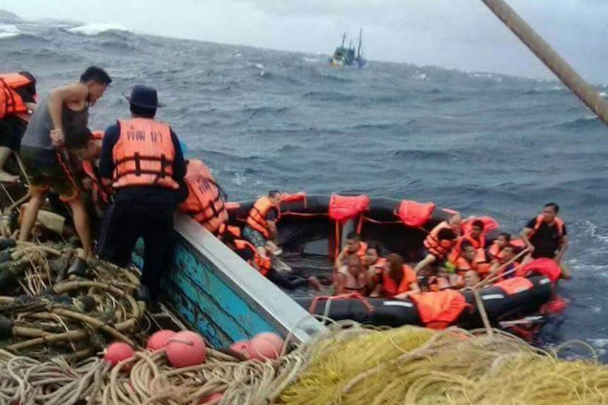 Fishermen and marine police coming to their rescue after two tour boats sank off Phuket, forcing about 130 tourists into the sea, on July 5, 2018.
