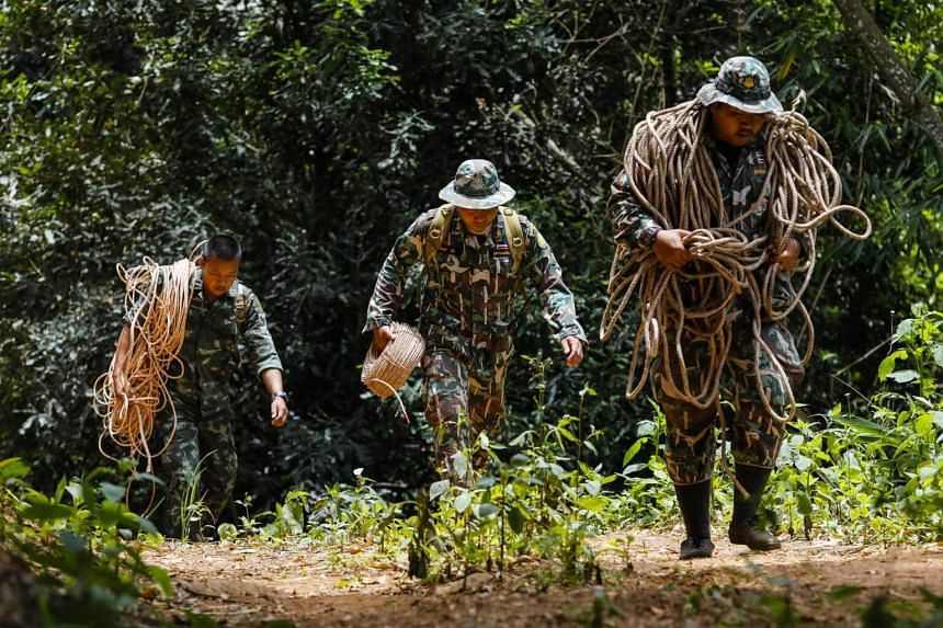 Thai park rangers carry ropes to assist a group of bird's nest collectors (not pictured) in Khun Nam Nang Non Forest Park in the Mae Sai district of Chiang Rai province, on July 5, 2018.