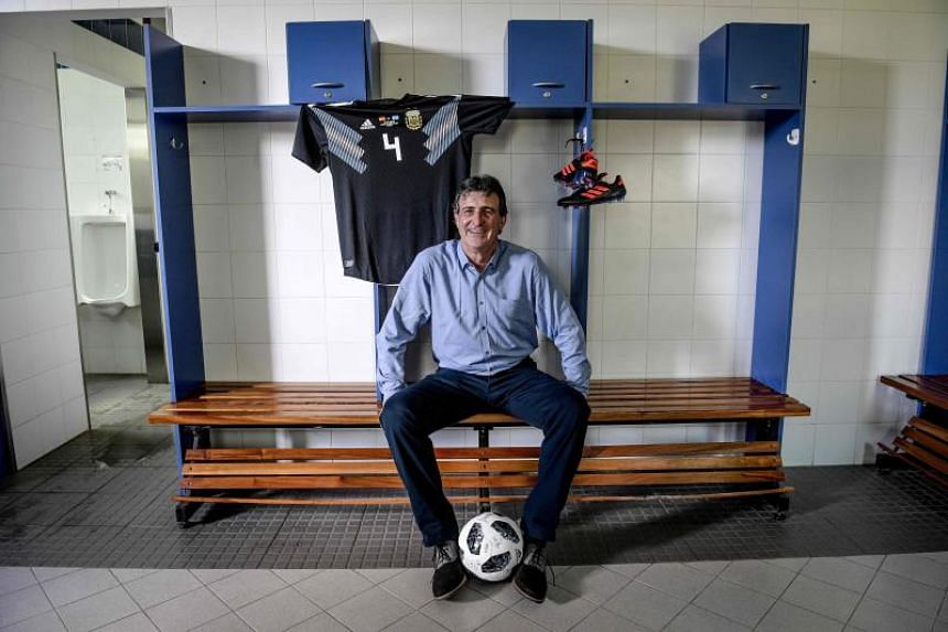 Argentina's former football star player Mario Kempes poses in a locker room in Ezeiza, Argentina, on March 29, 2018.
