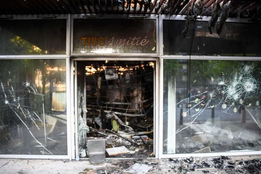 A ransacked store is pictured in the Breil neighborhood of Nantes, northwestern France, on July 5, 2018.