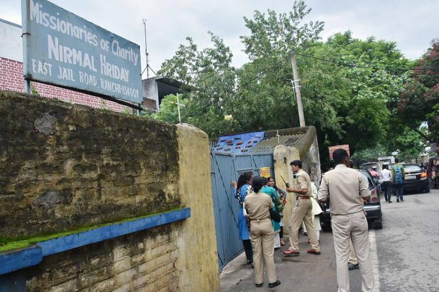 Indian police gather outside the premises of Mother Teresa's Missionaries of Charity where a staff member and a nun worked before their arrest on child trafficking charges in Ranchi in India's eastern Jharkhand state.