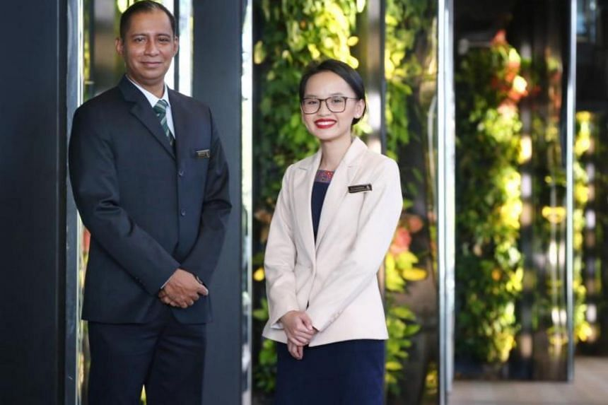 Leading steward Nizam Kamarraj (left) and customer service officer Nurfatinahidora Mohd Amin were among eight recipients of the Soaring Star award, given out at the Singapore Airlines CEO Service Excellence Awards.