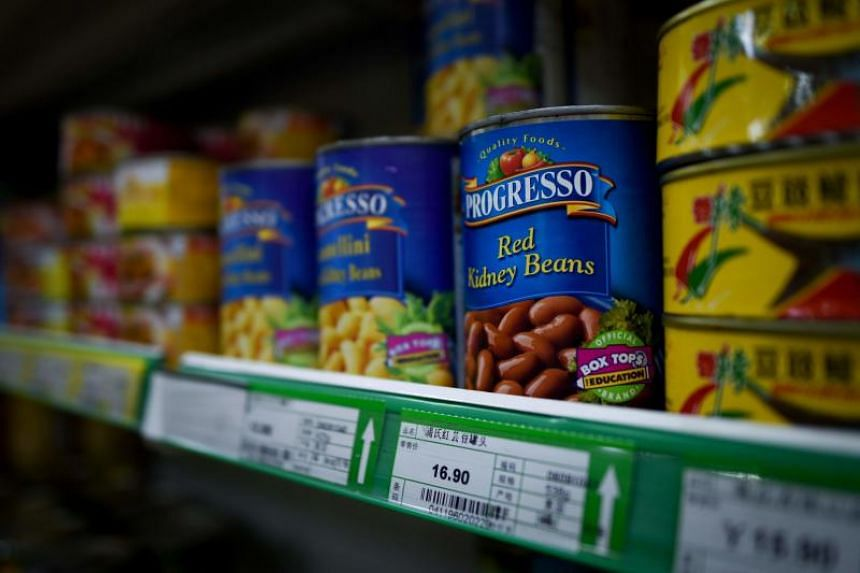 Cans of imported US kidney beans are seen at a supermarket in Beijing on July 6, 2018.