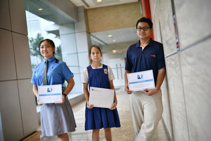 (From left) Diyana Phang, Mia Katriel Tay and Arash Nur Iman, all 13, with their awards after the ceremony on July 6, 2018.