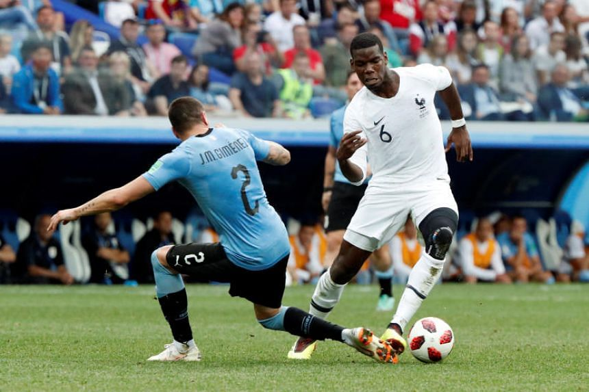 France's Paul Pogba in action with Uruguay's Jose Gimenez in the match on July 6, 2018.