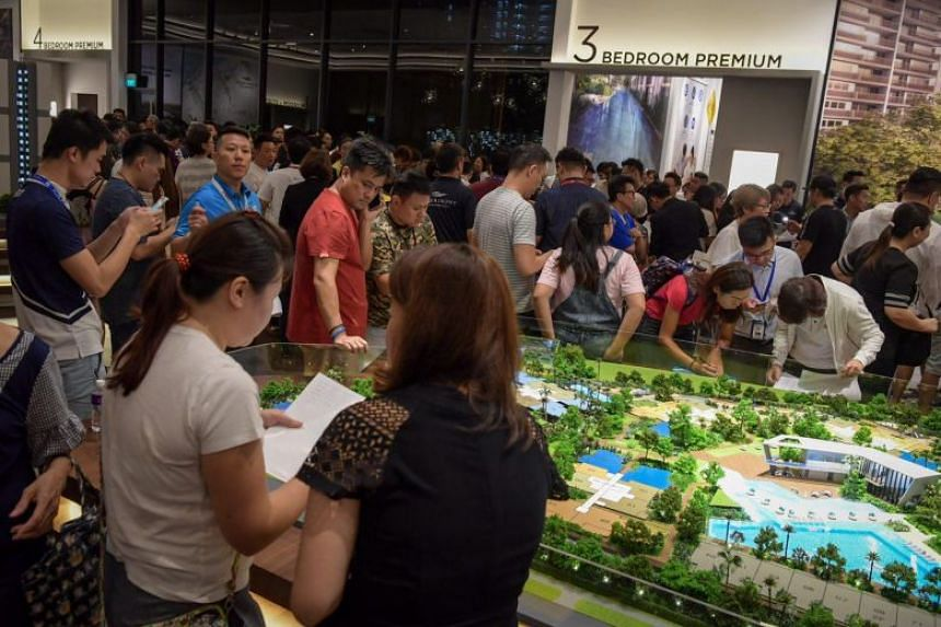 Visitors at the show-flat of Riverfront Residences, a new condominium development in Hougang, on July 5, 2018.