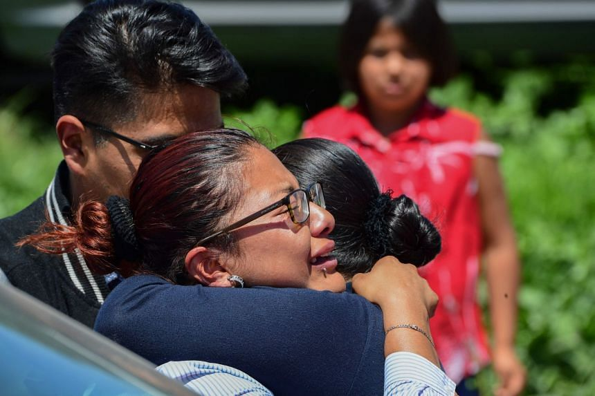 Women embrace at the site in Tultepec, central Mexico.