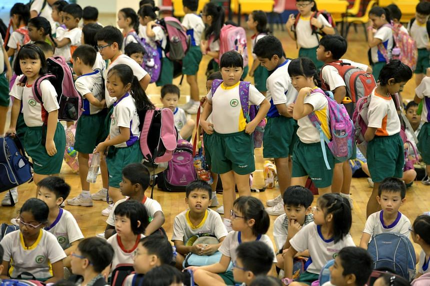 Primary school students during assembly. Parents might have to face balloting for the P1 registration exercise.