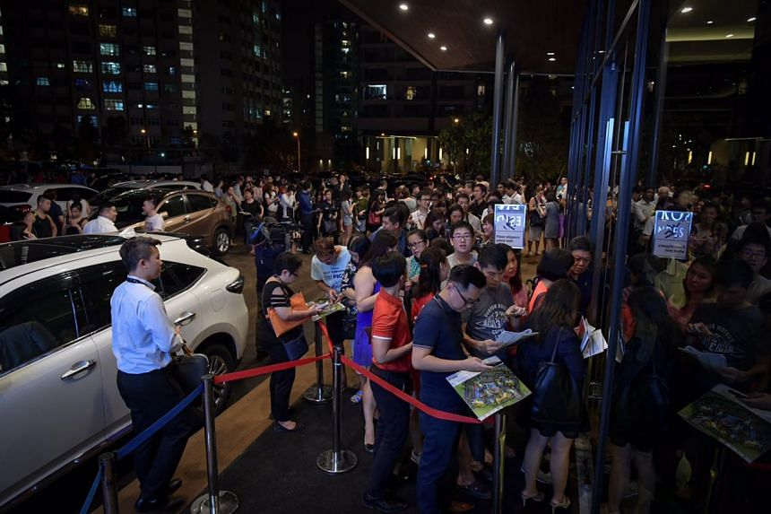 Visitors queueing to enter the show-flat of Riverfront Residences, a new condominium development in Hougang, on July 5, 2018.