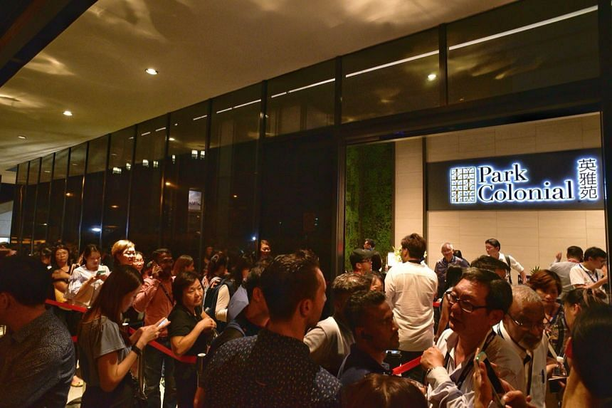 People waiting to enter the sales office of Park Colonial, a new condominium development in Woodleigh Lane, on July 5, 2018.