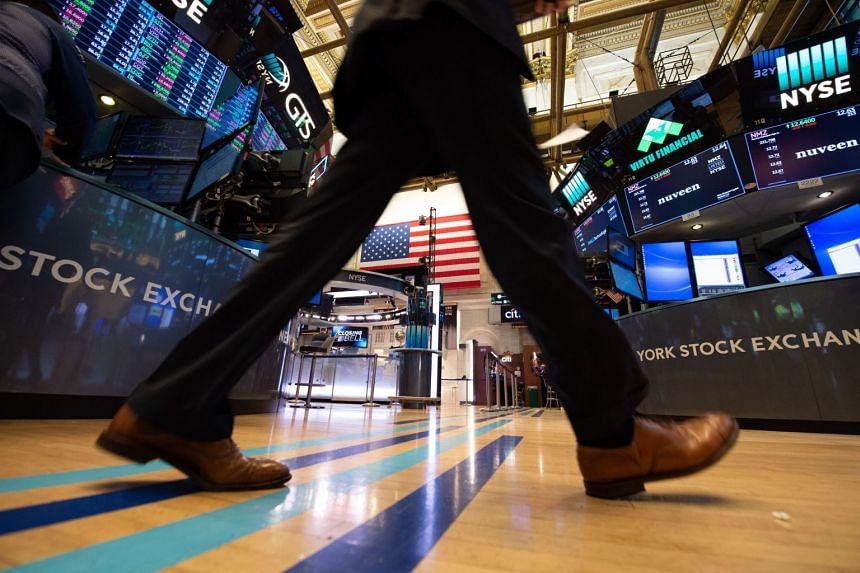 Traders work on the floor at the closing bell of the Dow Industrial Average at the New York Stock Exchange on July 5, 2018 in New York.