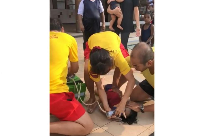 In the video uploaded by Facebook user Wong Chee Wai, Sport Singapore lifeguards are seen attending to the boy, who is lying by the edge of the pool.