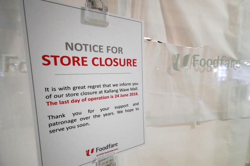 A store closure notice by NTUC Foodfare at Kallang Wave Mall. It had reduced the number of stalls in the food court in 2016, even as stallholders complained of poor traffic.