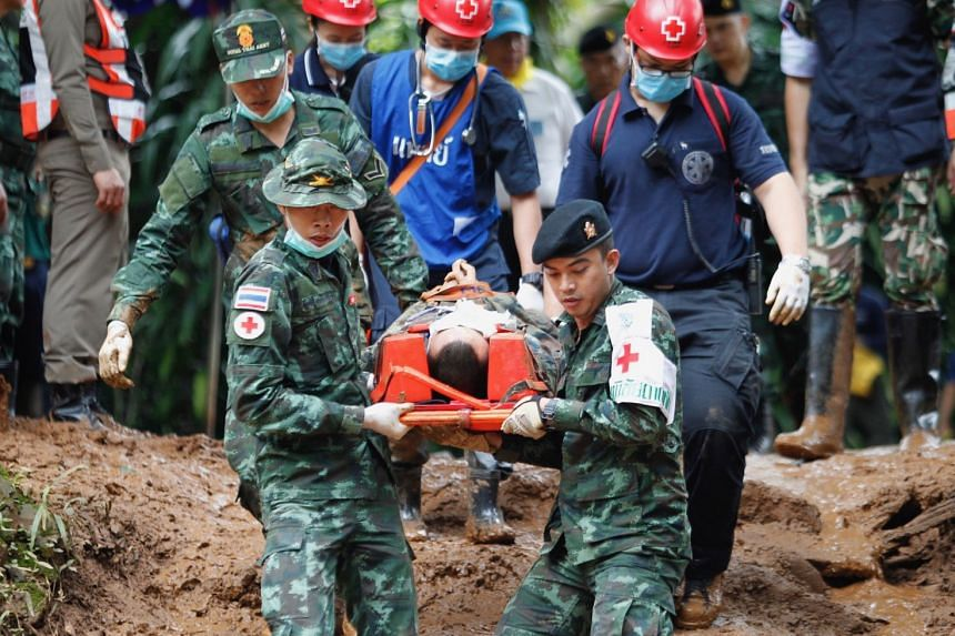 Thai military medical personnel and associated officials practice carrying an injured person.