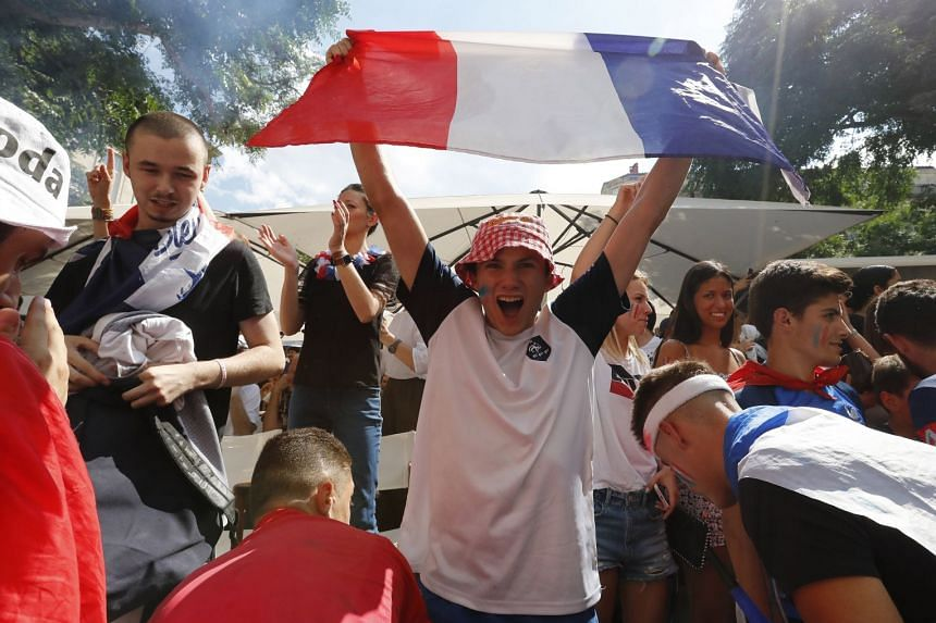 French supporters celebrate a goal as they watch a broadcast of the France versus Uruguay quarter-final.