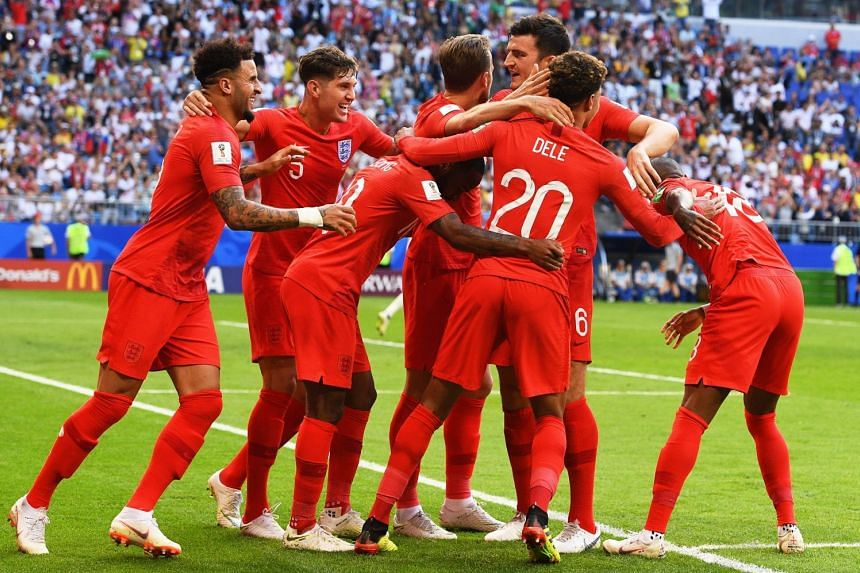 Dele Alli of England celebrates with his team-mates after scoring the second goal in his team's 2-0 quarter-final win over Sweden.