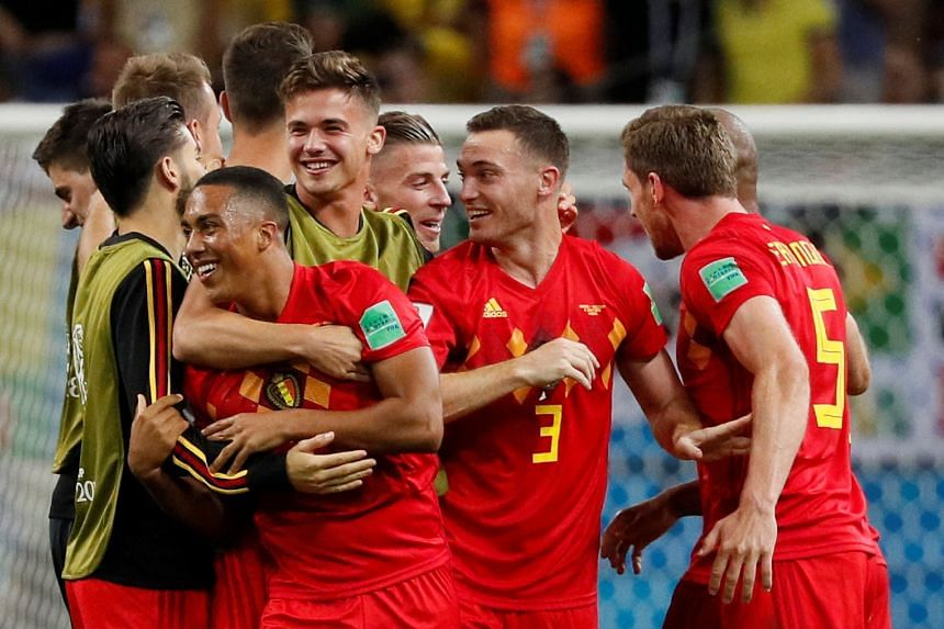 Belgium's Youri Tielemans celebrates with teammates after the match.