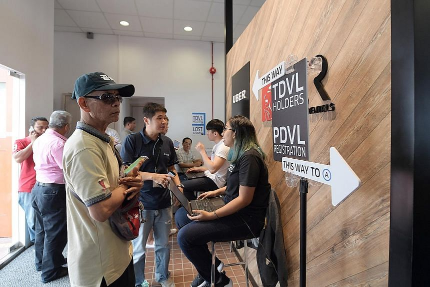 Applicants for the mandatory Private Hire Car Driver's Vocational Licence at UberHub in Paya Lebar in June last year. A one-year concession period was given for them to pass the test for the licence.