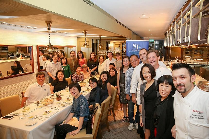 The ST subscribers got to dine on a six-course dinner whipped up by Fratelli's celebrity chefs Roberto (fifth from right) and Enrico (fourth from right) Cerea, from restaurant Da Vittorio, a three-Michelin-star restaurant in Bergamo, Italy, together