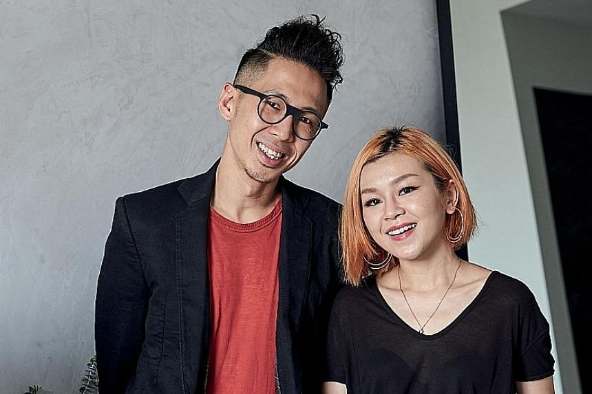 Some of home owners Joseph Ho and Evon Chng's (both above) favourite things, including their collection of photographs and fashion items (left), are displayed on shelves in the master bedroom. White subway tiles on the bathroom walls contrast with bl