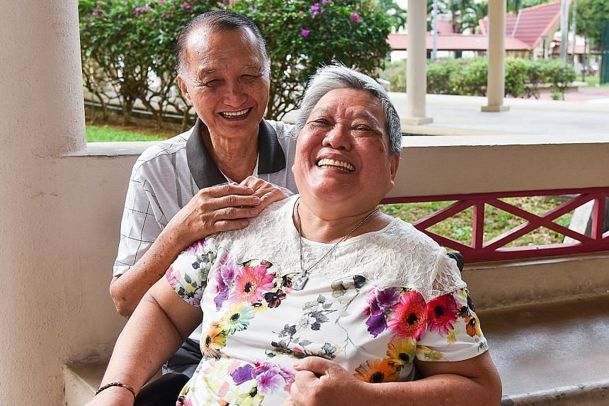 Above: Madam Oei Lian Eng with her husband, Mr Tan Sue Hoai, who is her sole caregiver. Above right: Madam Oei is helped by Mr Colin Teo, 59, in her rehabilitation at The Salvation Army Peacehaven Bedok Multi-Service Centre, where she goes for day ca