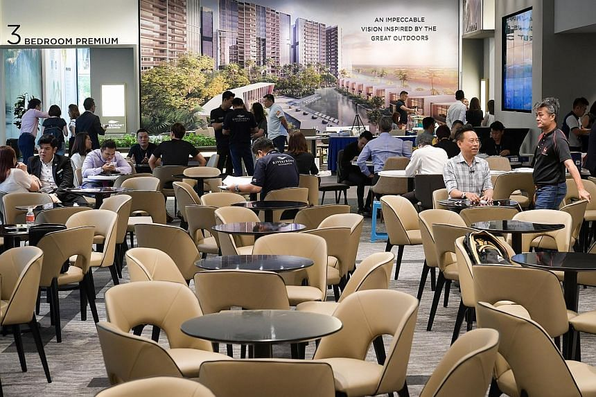 Riverfront Residences' showflat after the property cooling measures kicked in. The Hougang project's original launch date was this weekend, but it was brought forward to allow buyers to lock in deals. The crowd at the Riverfront Residences showflat b