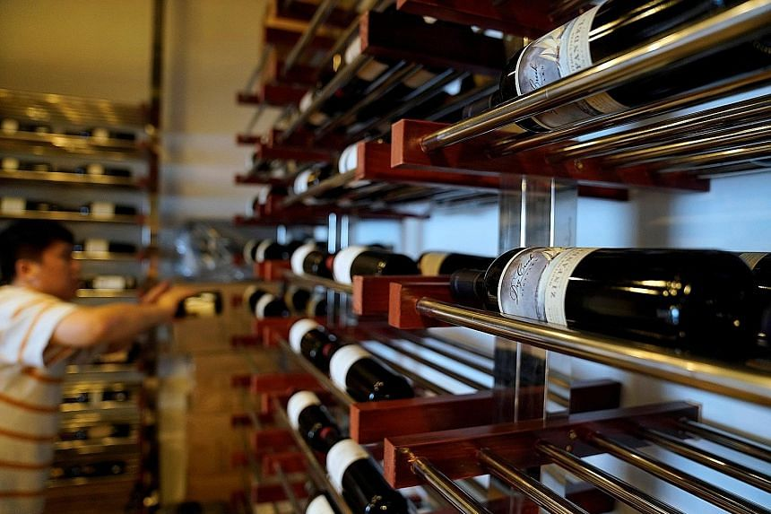 Bottles of red wine imported from the US in Shanghai. American goods from wine to potato chips are disappearing from some stores in China as importers turn to substitutes from other places. The tariffs have hurt profit margins for American products i