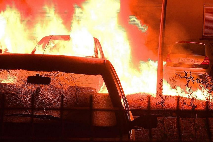 Around 50 cars were torched early yesterday in Nantes and there were arson attempts on a high school and a petrol station, the fire service said, but no injuries were reported. A policeman has been held for questioning over the killing of the man, wh