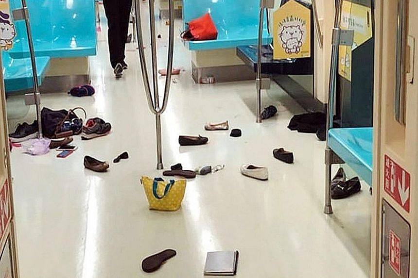Belongings strewn on the floor of the train, left behind by commuters after they fled to another carriage when they spotted the rat.