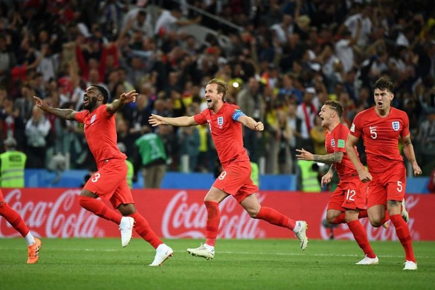 England's players celebrate after winning their Russia 2018 World Cup round of 16 football match against Colombia at the Spartak Stadium in Moscow, on July 3, 2018.