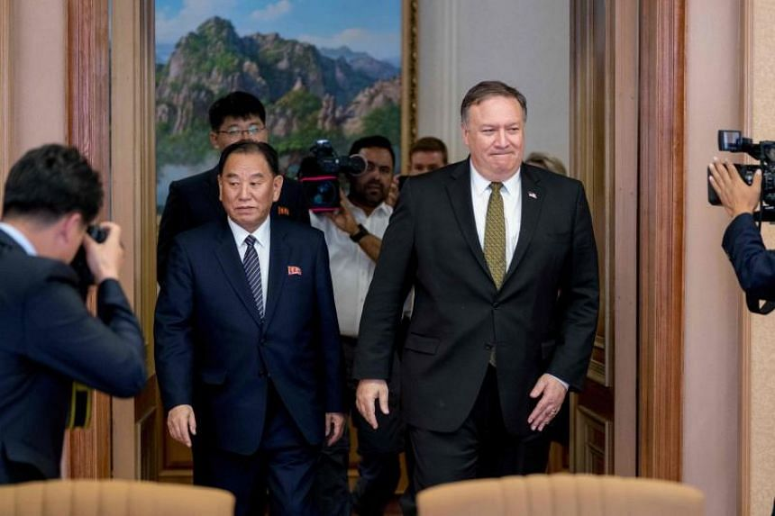 US Secretary of State Mike Pompeo (right) and Kim Yong Chol, North Korean senior ruling party official and former intelligence chief, return to discussions after a break at Park Hwa Guest House in Pyongyang, on July 7, 2018.