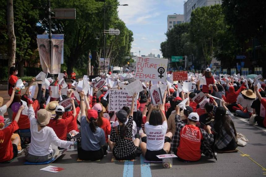 Female protesters call for South Korea's government to crack down on widespread spycam porn crimes during a rally in Seoul, on July 7, 2018.