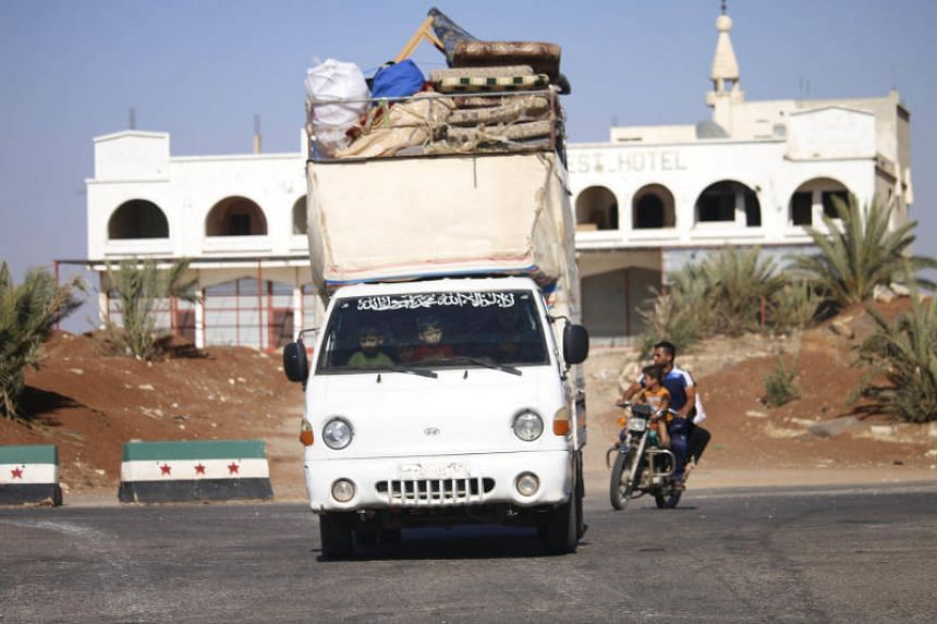 Syrians return to their homes in towns and villages situated on the eastern outskirts of Daraa, on June 6, 2018.