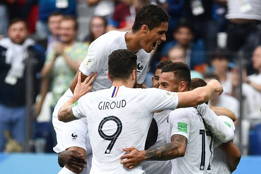France's players celebrate their second goal.
