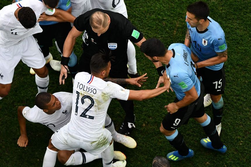 Argentine referee Nestor Pitana separates players during the match.