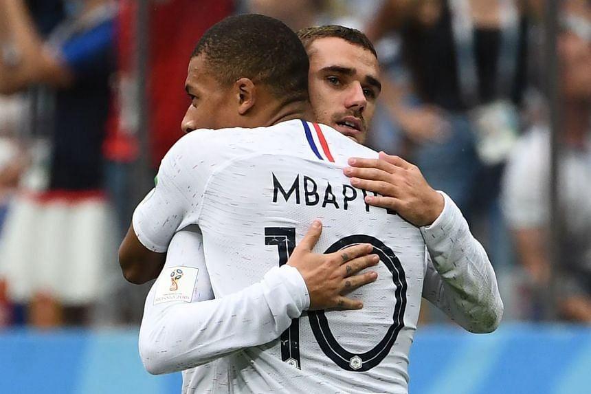 France's forward Antoine Griezmann (right) celebrates scoring his team's second goal with Kylian Mbappe.