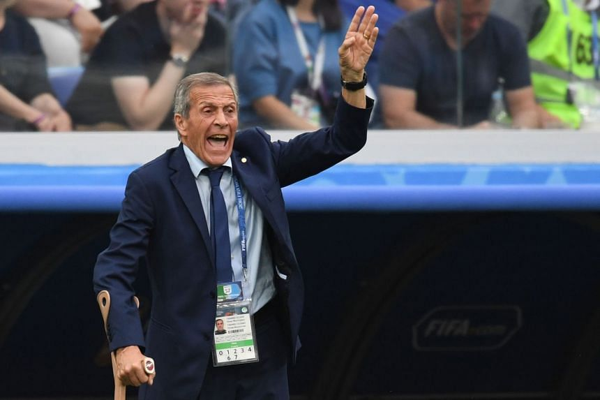 Tabarez gestures from the sideline during the match.
