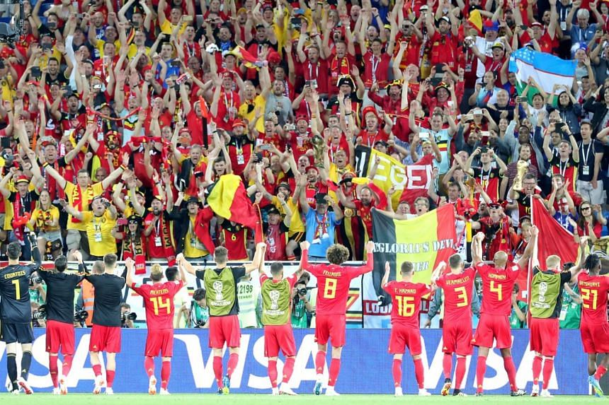 Players of Belgium celebrate with their fans after the FIFA World Cup 2018 group G preliminary round football match between England and Belgium in Kaliningrad, Russia, on June 28, 2018.