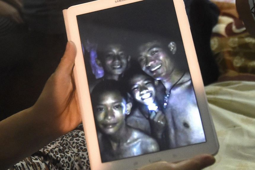 Ekkapol Chantawong (right), was the only adult with the children until they were discovered on a muddy ledge by rescue divers, on July 2, 2018. The image displayed is believed to have been taken in 2017.