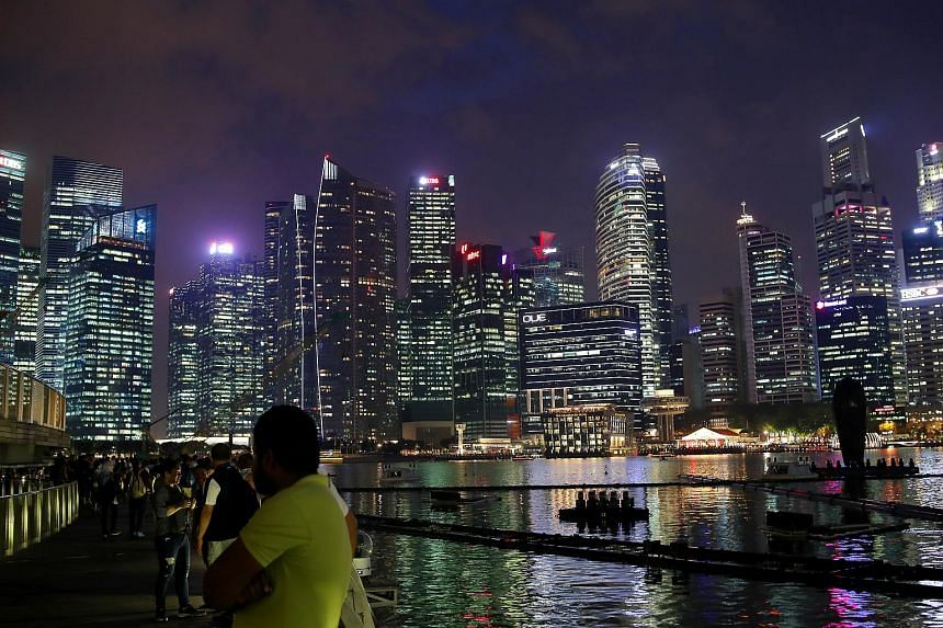 The night scene of Singapore, one of the seven South-east Asian cities are driving the rate of urbanisation.