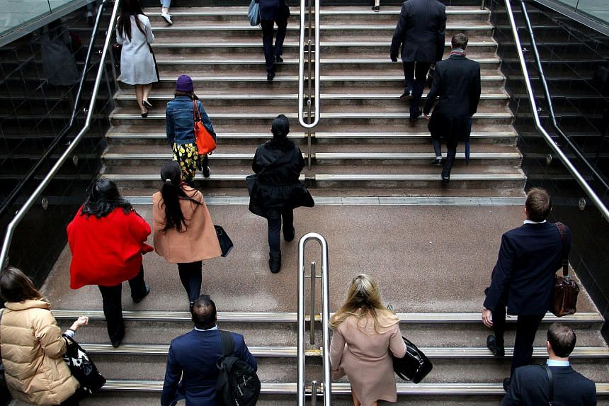 Commuters walk up a flight of stairs at Martin Place in the central business district of Sydney, Australia. Firefighters were deployed to fix a gas leak at Martin Place late on July 6, with large sections evacuated and closed to traffic.